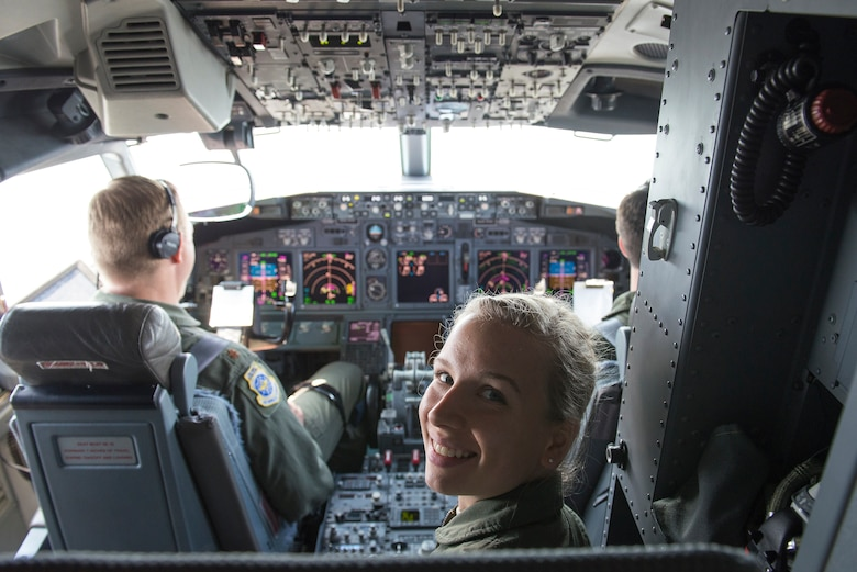 Cadet 2nd Class Kirsten Mattson sits in the cockpit of a C-40 June 8, 2015, at Scott Air Force Base, Illinois. Mattson was one of 10 Air Force Academy cadets who visited Scott to learn more about the variety of career fields in the Air Force. Mattson is a rising junior at the Air Force Academy. (U.S. Air Force Photo by Airman 1st Class Megan Friedl)