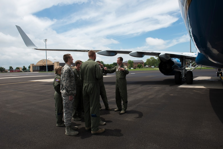 Maj. Jonathan Lauer talks to cadets outside a C-40 June 8, 2015, at Scott Air Force Base, Illinois. Lauer informed the Air Force Academy cadets about the aircraft and answered any of their questions. Lauer is a 54th Airlift Squadron C-40 Pilot. (U.S. Air Force Photo by Airman 1st Class Megan Friedl)