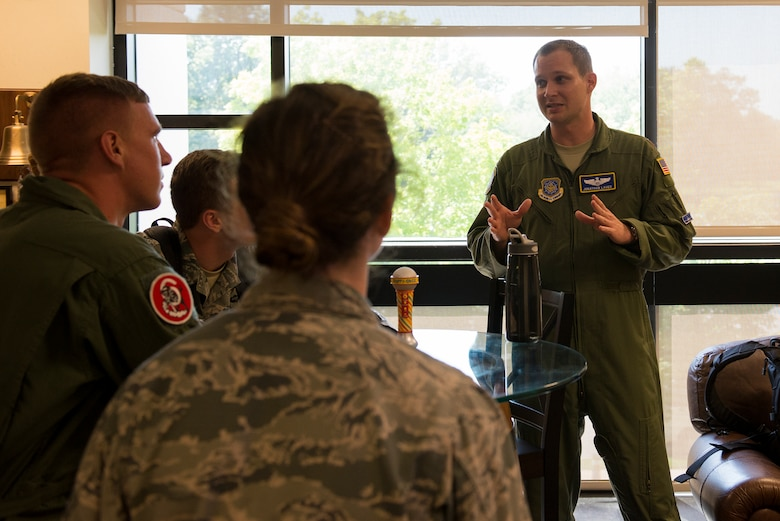 Maj. Jonathan Lauer talks to cadets after flying on a C-40 June 8, 2015, at Scott Air Force Base, Illinois. Lauer informed Air Force Academy cadets about the normal procedures done after a flight. Lauer is a 54th Airlift Squadron C-40 Pilot. (U.S. Air Force Photo by Airman 1st Class Megan Friedl)