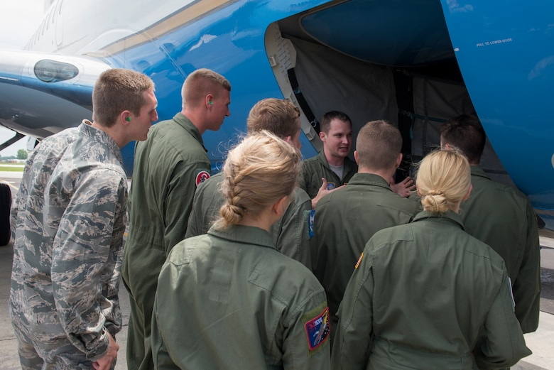 Maj. Jonathan Lauer shows the cadets the exterior of a C-40 and explains to them how to do a pre- flight check June 8, 2015 at Scott Air Force Base, Illinois. The cadets were from the Air Force Academy learning a new perspective from officers. (U.S. Air Force Photo by Airman 1st Class Megan Friedl)