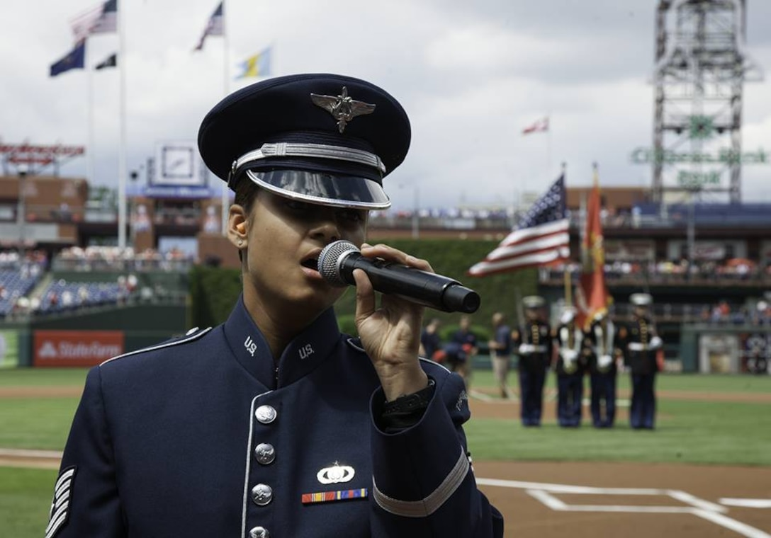 Tech. Sgt. Nalani Quintello sings 'America the Beautiful' and the national anthem at Citizens Bank Park in Philadelphia, Pennsylvania, June 6, 2015. On the 71st Anniversary of D-Day, the Philadelphia Phillies recognized military veterans before the game and featured military members throughout the game. (U.S. Air Force photo/Airman 1st Class Philip Bryant)