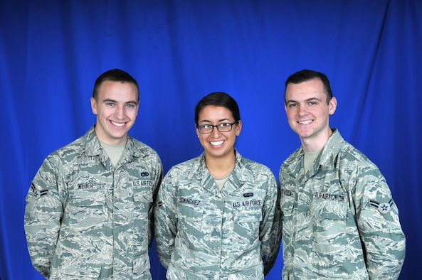 U.S. Air Force Airmen 1st Class Ryan Weber, Sharon Dominguez and Luke McFadden pose for a photo. The three Airmen from the Delaware Air National Guard's 166th Airlift Wing in New Castle, Del. have the U.S. Air Force Academy in their future. (U.S. Air National Guard photo by 1st Lt. Valerie Harwood)
