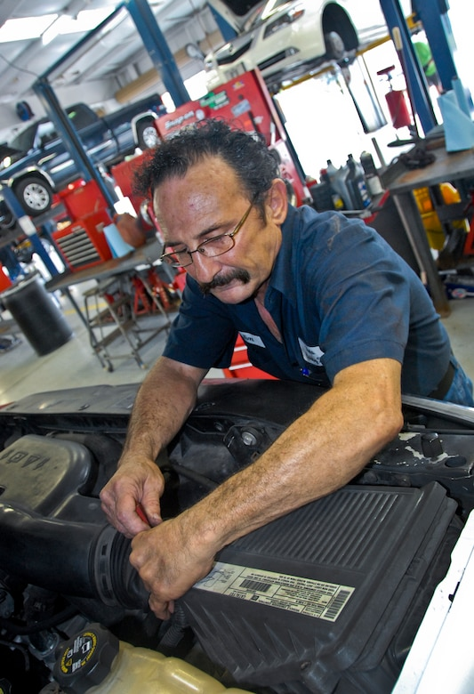 Auto hobby shop services eglin communitys vehicles eglin air jim lufrano an auto hobby shop mechanic checks a cars air filter at eglin solutioingenieria