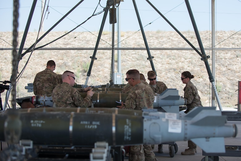 U.S. Airmen assigned to the 455th Expeditionary Maintenance Squadron Munitions Flight perform six month inspections on Guided Bomb Unit-54 (GBU-54) munitions at Bagram Airfield, Afghanistan, June 15, 2015. The 455th EMXS Munitions Flight ensures that every munition loaded onto an F-16 Fighting Falcon will perform as expected when used. (U.S. Air Force photo by Tech. Sgt. Joseph Swafford/Released)