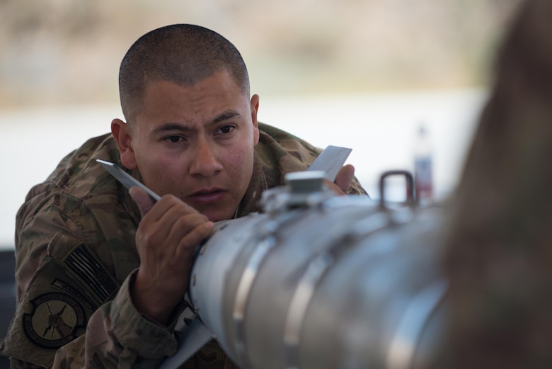 U.S. Air Force Staff Sgt. Luis Soto, 455th Expeditionary Maintenance Squadron Munitions Flight conventional maintenance/precision guided munitions production superintendent, completes a six month inspection on a Guided Bomb Unit-54 (GBU-54) munition at Bagram Airfield, Afghanistan, June 15, 2015. The 455th EMXS Munitions Flight ensures that every munition loaded onto an F-16 Fighting Falcon will perform as expected when used. (U.S. Air Force photo by Tech. Sgt. Joseph Swafford/Released)