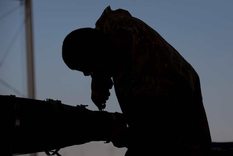 U.S. Air Force Airmen 1st Class Aaron Funck, 455th Expeditionary Maintenance Squadron Munitions Flight munitions technician, completes a six month inspection on a Guided Bomb Unit-54 (GBU-54) munition at Bagram Airfield, Afghanistan, June 15, 2015. The 455th EMXS Munitions Flight ensures that every munition loaded onto an F-16 Fighting Falcon will perform as expected when used. (U.S. Air Force photo by Tech. Sgt. Joseph Swafford/Released)