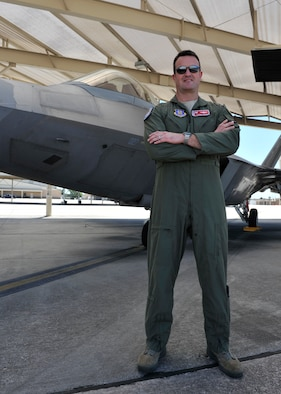 Lt. Col. Randall Cason, 301st Fighter Squadron commander, stands in front of an F-22 Raptor May 18 on the flightline at Tyndall Air Force Base, Fla. In 2006, Cason became the first Air Force Reserve pilot to fly the F-22. (U.S. Air Force photo by Airman 1st Class Sergio A. Gamboa)