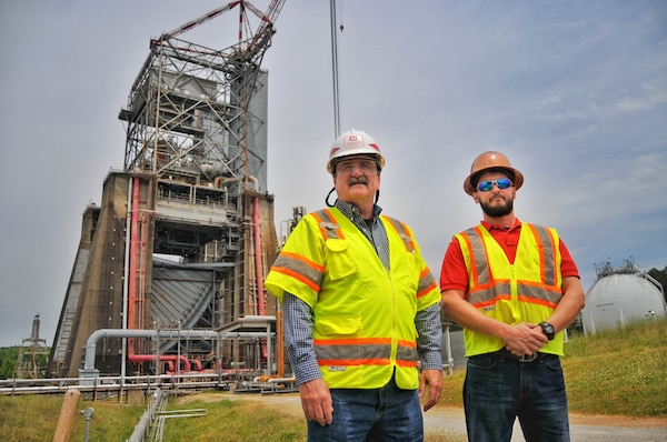 Brad Butler, right, who works in safety as a contractor for Marshall Engineering Technicians and Trades Support Services, followed his father Donnie's footsteps into a career in safety. Donnie is an occupational safety and health specialist for the Corps of Engineers, Huntsville Center.