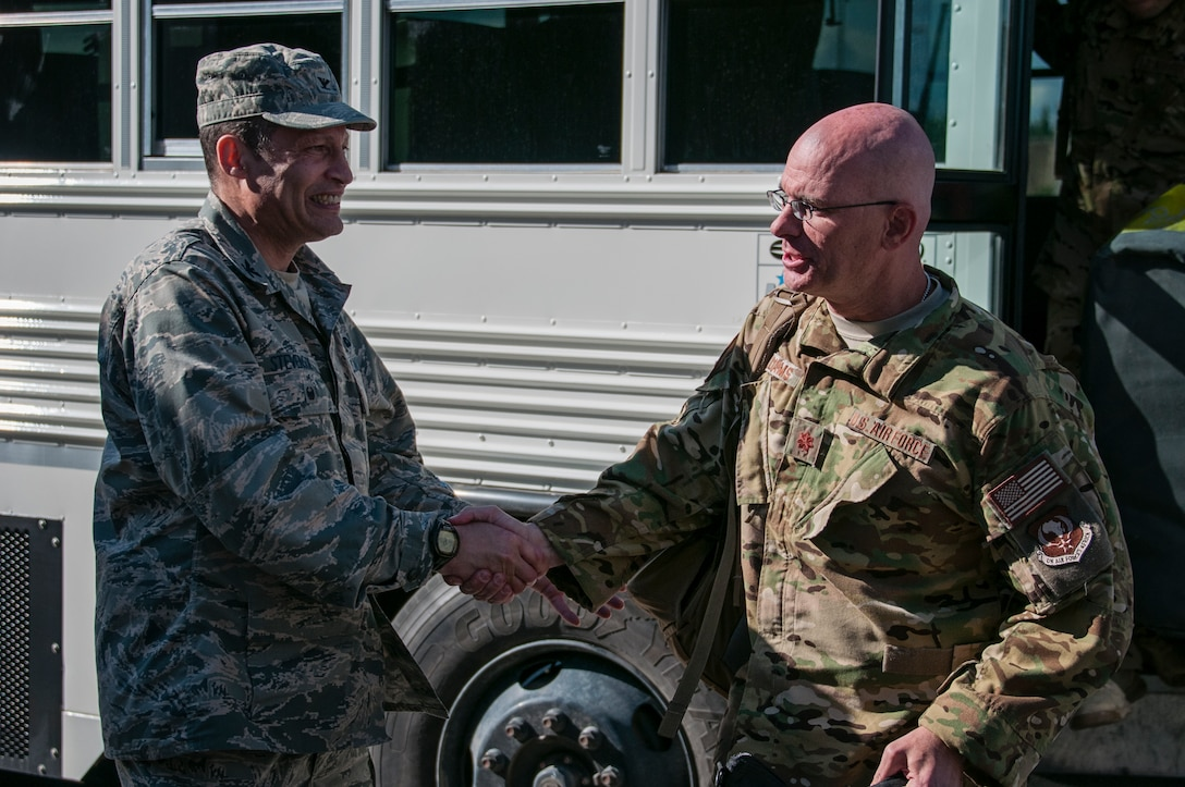 Alaska Air National Guardsman Maj. Andrew Williams, 176th Wing Operations Group, is greeted by Col. Charles Stevenson, vice commander of the 176th Wing, at Joint Base Elmendorf-Richardson on June 12,2015. Williams, along with 15 other Guardsmen from the 210th Rescue Squadron, the 211th Rescue Squadron and the 176th Logistics Readiness Squadron, returned from a four-month deployment to Djibouti in support of Operation Enduring Freedom. (Air National Guard photo by Staff Sgt. Edward Eagerton/released)