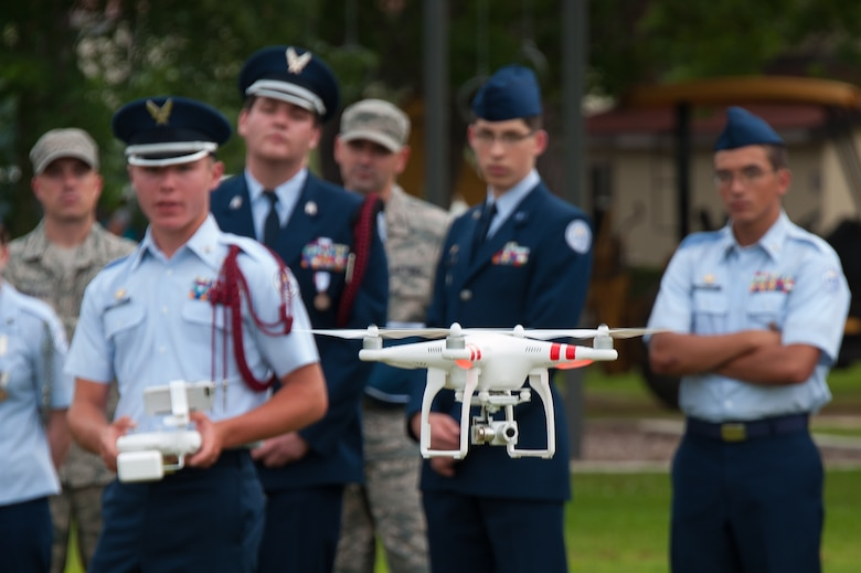 Cadet Senior Airman Cody Powell, Niceville High School Junior Reserve Officer Training Corps, maneuvers a multicopter during a demonstration held at Maxwell Air Force Base, Alabama, June 10, 2015.  About 17 cadets from the Florida high school were at Maxwell to demonstrate the capabilities of their newest science, technology, engineering and mathematics, or STEM, teaching and learning tool they call the multicopter, or quadcopter, a remote-controlled aircraft propelled by four rotors. Cadets learn how to fly the multicopter and maneuver its camera while also learning how to work in a team environment.  (Air Force Photo by Melanie Rodgers Cox/Cleared)