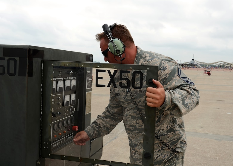 Senior Master Sgt. Phil Johnson, maintenance flight chief with the 131st Maintenance Squadron, assists civil and military aerial performers with aircraft ground support services such as refueling and filling oil smoke tanks used during performances during the Wings Over Whiteman air show June 13, 2015.  A number of Citizen-Airmen from the Missouri Air National Guard's 131st Bomb Wing were on hand to support the two-day event.  (U.S. Air National Guard photo by Airman 1st Class Halley Burgess)