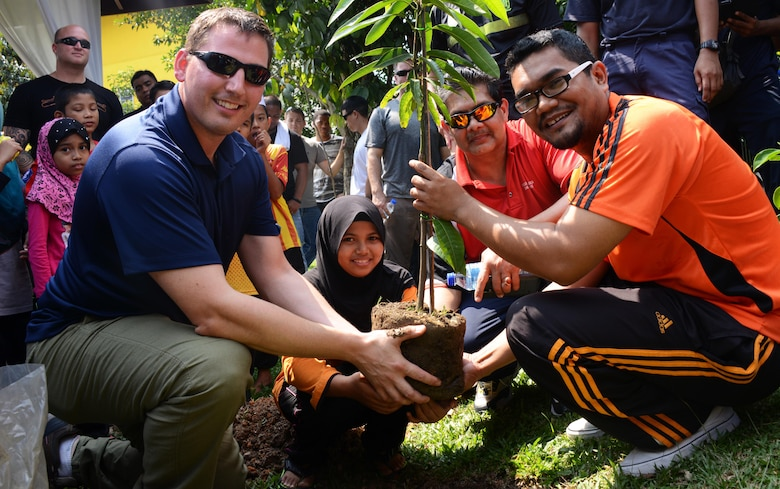 A member from the 353rd Special Operations Group and the Royal Malaysian Air Force play soccer with the children at the Rumah Kasih Hormoni Orphanage near Kuala Lumpur, Malaysia, June 6, 2015.  As part of Exercise Teak Mint, members from the RMAF, U.S. Air Force came together to help with repairs around the orphanage and donated more than $1,000 in clothes, games and sports equipment.  (U.S. Air Force photo by Tech. Sgt. Kristine Dreyer)