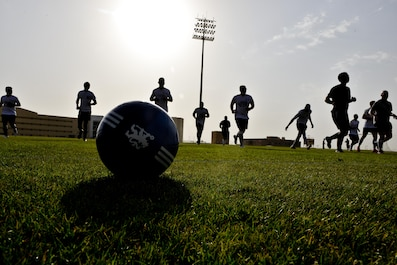 Members of the Al Udeid All-Stars conduct warm up exercises prior to a soccer match against Qatari military members in celebration of the 240th U.S.  Army birthday June 14, 2015 at Al Udeid Air Base, Qatar. AUAB All-Stars planned a soccer match to help strengthen the partnership between the U.S. and Qatari military and build friendships between service members. (U.S. Air Force photo/Staff Sgt. Alexandre Montes)