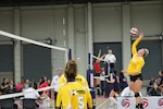 Army 1st Lt. Alexandra Giraud of Schofield Barracks, Hawaii spikes the ball during Army's gold medal run for their third straight year during the 2015 Armed Forces Volleyball Championship held in conjunction with the USA Volleyball National Championship at the COBO Center in Detroit, Mich. 22-24.