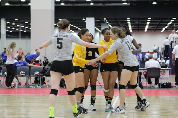 Members of the Army, Navy and Air Force women's volleyball team come together as an Armed Forces All-Star team as they faced Team Canada during friendly international Conseil International du Sport Militaire (CISM) exhibition match during the 2015 Armed Forces Volleyball Championship held in conjunction with the USA Volleyball National Championship at the COBO Center in Detroit, Mich. 22-24.  USA defeated Canada 2-1.