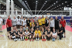 Service members from the Army, Navy and Air Force women's volleyball teams pose with Team Canada after a friendly international Conseil International du Sport Militaire (CISM) exhibition match during the 2015 Armed Forces Volleyball Championship held in conjunction with the USA Volleyball National Championship at the COBO Center in Detroit, Mich. 22-24.