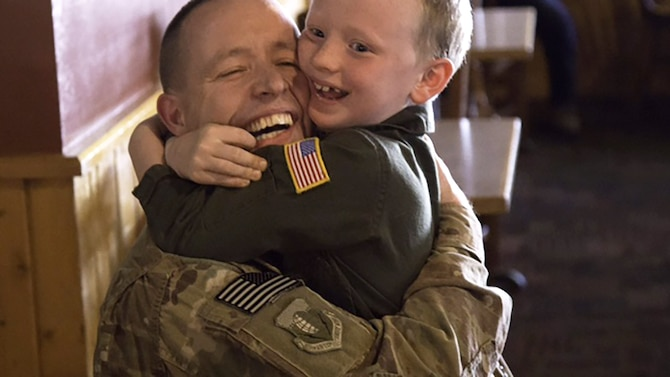 Chaplain (Capt.) Keith Manry greets his son, Benjamin, June 16, 2014, after returning from a deployment. Manry is assigned to the 341st Missile Wing at Malmstrom Air Force Base, Mont., and was recently awarded the Air Force Chaplain Corps Company Grade Officer Chaplain of the Year for 2014. (Courtesy photo)