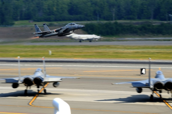 An F-15C Eagle from the 67th Fighter Squadron at Kadena Air Base, Japan, takes off during exercise Northern Edge from Joint Base Elmendorf-Richardson, Alaska, June 16, 2015. Northern Edge 2015 is Alaska's premier joint training exercise designed to practice operations, techniques and procedures as well as enhance interoperability among the services. Thousands of participants from all the services and components were involved. (U.S. Air Force photo/Staff Sgt. William Banton)