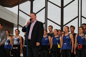 Chicago Blackhawks singer Jim Cornelison sings the national anthems of both the United States and Canada as the 2015 Armed Forces Triathlon Championship kicks off at Wolf Lake in Hammond, Ind. in conjunction with Leon's Triathlon on June 7th.