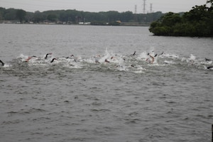 Start of the men's race of the 2015 Armed Forces Triathlon Championship at Wolf Lake in Hammond, Ind. held in conjunction with Leon's Triathlon on June 7, 2015.