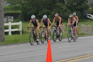 Armed Forces Women's Triathlon Champion Army 2nd lt. Samone Franzese of Fort Sam Houston, Texas (center) along with other women riders during the 2015 Armed Forces Triathlon Championship at Wolf Lake in Hammond, Ind. held in conjunction with Leon's Triathlon on June 7, 2015.