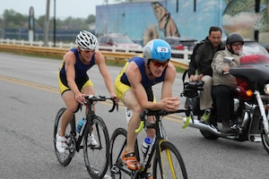 Navy Lieutenans Derek Oskutis (front) of NB San Diego, Calif. and 2015 Armed Forces Triathlon Champion Kyle Hooker of NAS Whidbey Island, Wash. take a commanding lead in the road race portion of the 2015 Armed Forces Triathlon Championship at Wolf Lake in Hammond, Ind. held in conjunction with Leon's Triathlon on June 7, 2015.