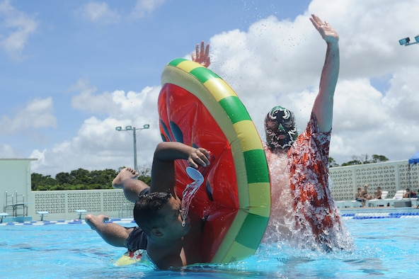 """Common Sense Lucha"" helps an Airman make good choices while enjoying the summer sun at Kadena Air Base's Hagerstrom Pool, June 18, 2015. Alcohol numbs the senses and reduces reaction time, a combination which significantly increases the risk of drowning. If you plan to drink around water, be sure to practice personal risk management and always have a wingman. (U.S. Air Force photo by Airman 1st Class Zade C. Vadnais)"