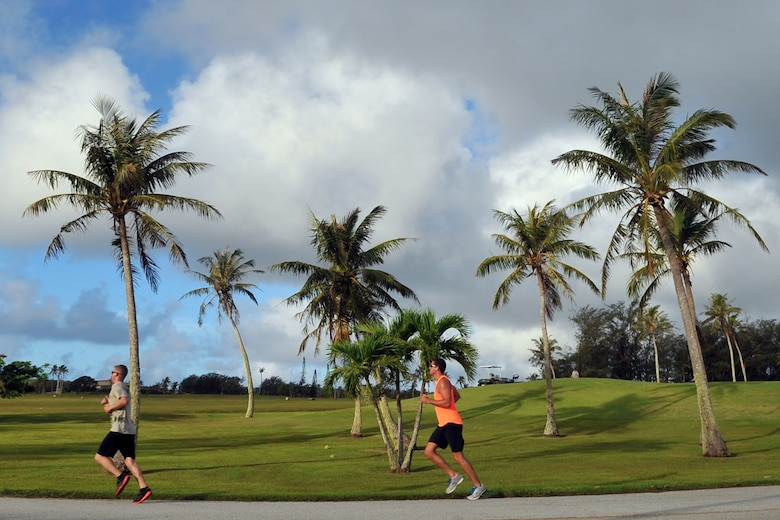 Participants run toward the finish line of the Father's Day 5K June 19, 2015, at Andersen Air Force Base, Guam. More than 100 Team Andersen members gathered for the event to commemorate Father's Day, which is held June 21 this year. (U.S. Air Force photo by Staff Sgt. Melissa B. White/Released)