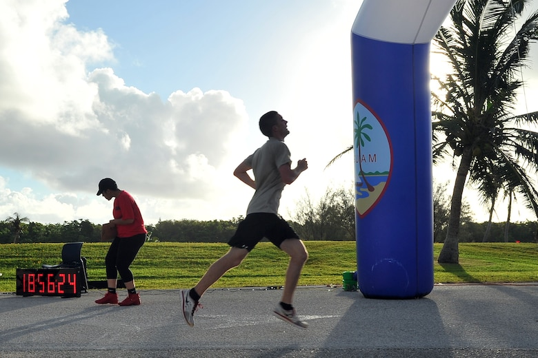 Ryan Richardson, 736th Security Forces Squadron, finishes the Father's Day 5K in second place June 19, 2015, at Andersen Air Force Base, Guam. More than 100 Team Andersen members gathered for the event to commemorate Father's Day, which is held June 21 this year. (U.S. Air Force photo by Staff Sgt. Melissa B. White/Released)