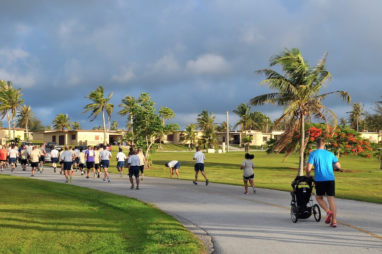 Runners participate in a Father's Day 5K June 19, 2015, at Andersen Air Force Base, Guam. More than 100 Team Andersen members gathered for the event to commemorate Father's Day, which is held June 21 this year. (U.S. Air Force photo by Staff Sgt. Melissa B. White/Released)
