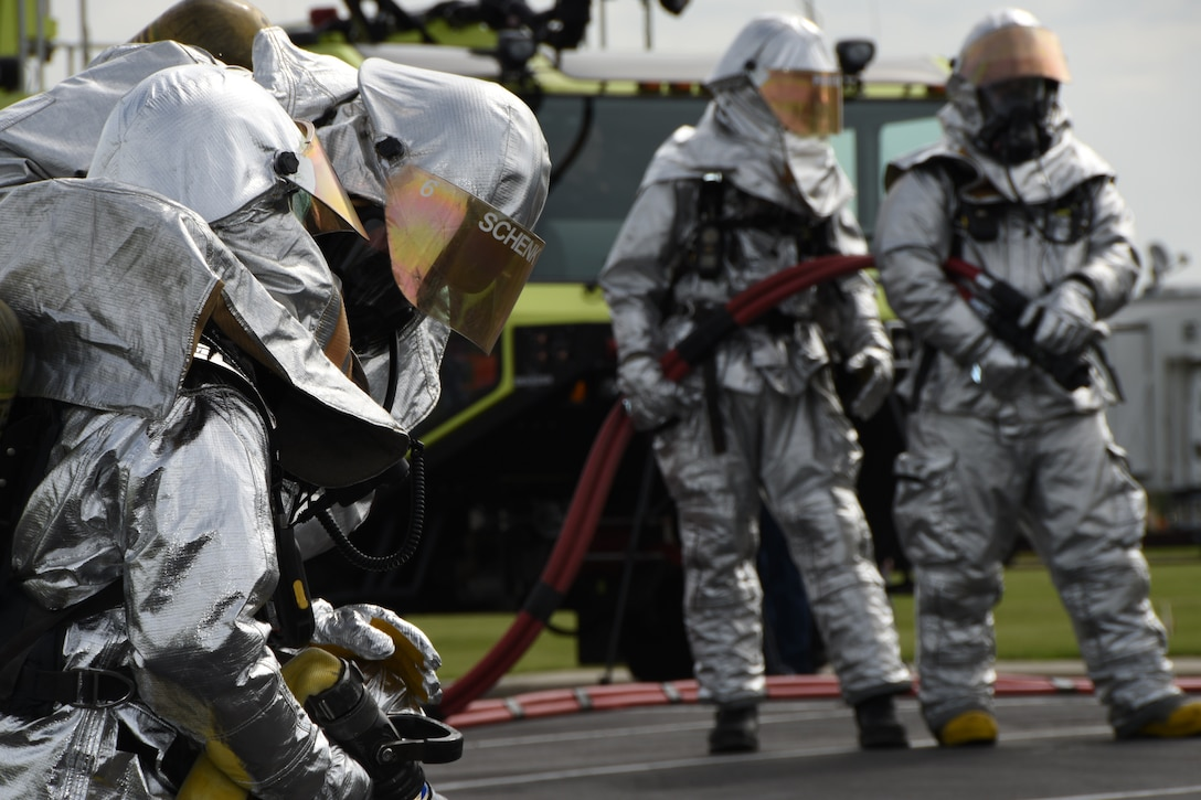 Firefighters from the 114th Civil Engineer Squadron simulates extinguishing a fire during the Major Accident Response Exercise June 18, 2015 Sioux Falls, S.D. The MARE involved the National guard, local law enforcement, firefighters, emergency medical technicians and the airport authority and is a three year requirement of the Federal Aviation Administration. (National Guard photo by Senior Airman Duane Duimstra)
