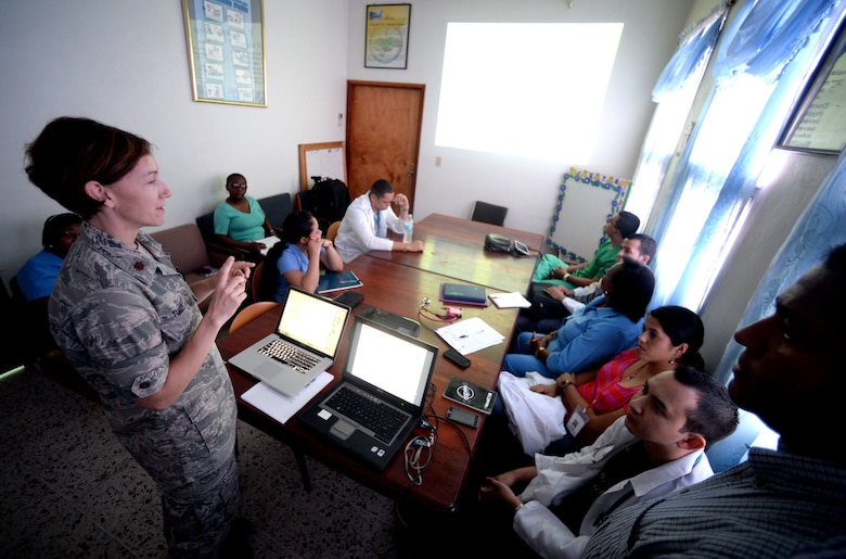 U.S. Air Force Maj. Charla Tully, Defense Institute for Medical Operations, infectious disease physician, Air Force Medial Support Agency, out of Joint Base San Antonio-Lackland, Texas, and Elk City, Okla., teaches doctors at the Dr. Salvador Paredes Hospital about malaria with translation assistance by Dr. Miguel Coello, Medical Element medical officer, Joint Task Force Bravo, out of Soto Cano Air Force Base, Honduras, and Tegucigalpa, Honduras native, in Trujillo, Honduras, June 17, 2015. Tully and Coello are part of vector-borne surveillance team working alongside the Honduran Ministry of Health in an effort to eradicate malaria in the Colón region of Honduras which is part of the New Horizons Honduras 2015 training exercise taking place throughout Tocoa and Trujillo. New Horizons was launched in the 1980s and is an annual joint humanitarian assistance exercise that U.S. Southern Command conducts with a partner nation in Central America, South America or the Caribbean. The exercise improves joint training readiness of U.S. and partner nation civil engineers, medical professionals and support personnel through humanitarian assistance activities. (U.S. Air Force photo by Capt. David J. Murphy/Released)