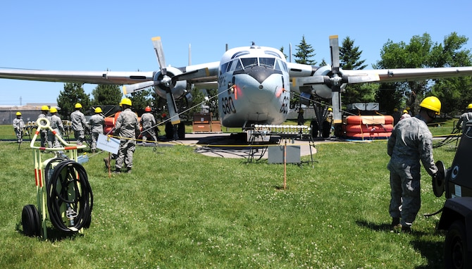 Personnel from the 914th Maintenance Squadron, Crash Damaged and Disabled Aircraft Recover Team conduct a simulated crash and recovery exercise at the Niagara Falls Air Reserve Station on June 6, 2015. A team of more than 20 personnel simulated a crash and recovery exercise and familiarized themselves with equipment and procedures. (U.S. Air Force photo by Staff Sgt. Matthew Burke)