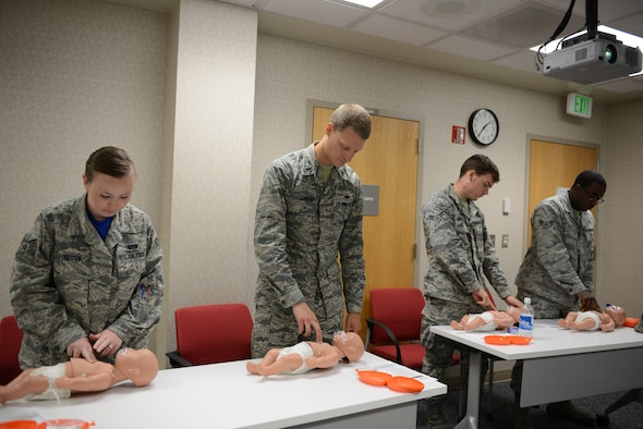 Andersen Airmen attend a Heartsaver CPR course June 12, 2015, at Andersen Air Force Base, Guam. The 36th Medical Group education and training section offers courses to provide the most accurate and up-to-date lifesaving practices for members. (U.S. Air Force photo by Airman 1st Class Arielle Vasquez/Released)
