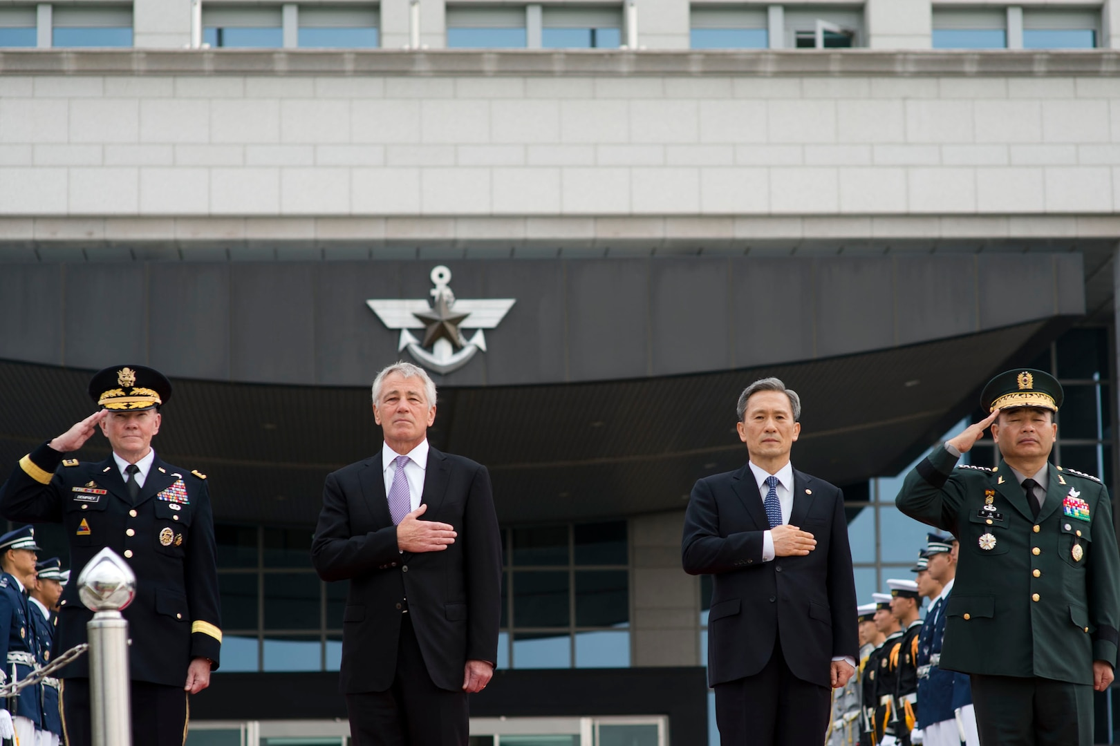 U.S. Defense Secretary Chuck Hagel, second from left, and U.S. Army Gen. Martin E. Dempsey, left, stand with South Korean Defense Minister Kim Kwan-jin, second from right, and South Korean army Gen. Jung Seung-jo, his country's chairman of the Joint Chiefs of Staff, during an honor cordon at the Ministry of Defense in Seoul, South Korea, Oct. 2, 2013. DOD photo by Erin A. Kirk-Cuomo