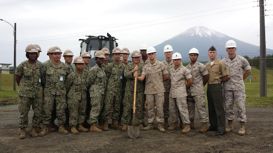 5 June 2015 - Camp Fuji, Gotemba, Shizuoka Pref., Japan - Colonel James Fullwood,  Commanding Officer of Combined Arms Training Center(CATC), Camp Fuji, takes a minute to thank the Seabees from NMCB-5. The Seabee Detachment recently arrived at CATC, Camp Fuji, and have already put their skills to great use by beginning the construction on a Vehicle Staging Lot. Once complete, the lot will allow for training units to pre-stage vehicles with ammo, prior to going into the field. This will allow for more time spent on the numerous live fire ranges offered at CATC Camp Fuji.