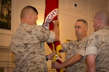 Brigadier General Kevin Killea passes the MCWL colors to Brigadier General Dale Alford during the Marine Corps Warfighting Laboratory's Change of Command ceremony.