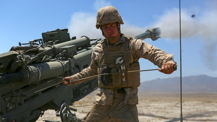 Lance Corporal Jarrett Ready, an artillery mechanic assigned to Company A, 1st Battalion, 11th Marine Regiment, 1st Marine Division, fires an M777 howitzer at Marine Corps Base Camp Pendleton, June 17, 2015. CH-53E Super Stallions transported howitzers and ammunition as part of 1/11's quarterly exercise to test the artillery Marines' proficiency and readiness for any scenario.