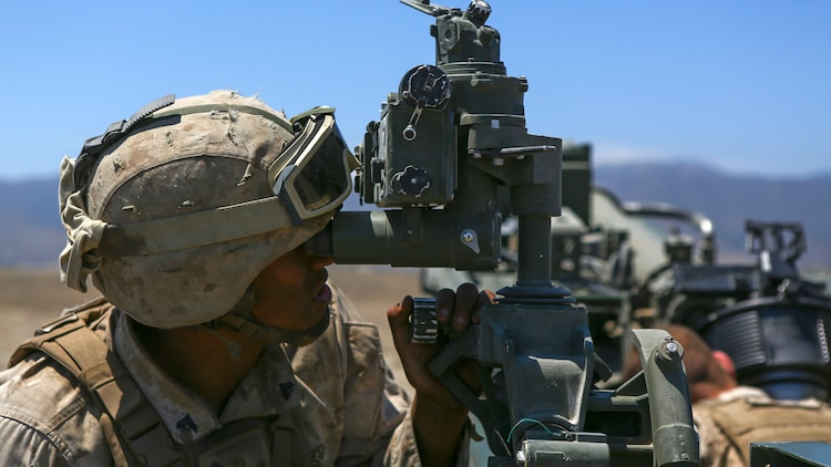 A Marine assigned to Company A, 1st Battalion, 11th Marine Regiment, 1st Marine Division, prepares an M777 howitzer to fire, at Marine Corps Base Camp Pendleton, June 17, 2015. CH-53E Super Stallions transported howitzers and ammunition as part of 1/11's quarterly exercise to test the artillery Marines' proficiency and readiness.