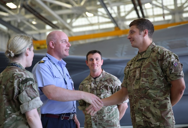 Air Commodore Harvey Smyth, left, shakes hands with Squadron Leader Hugh Nichols during a tour of Marine Fighter Attack Training Squadron 501, June 16. There are currently 14 U.K. pilots and maintainers with VMFAT-501 aboard Marine Corps Air Station Beaufort. Smyth is the lightning force commander, responsible for the F-35 program in the Royal Air Force. Nichols is the UK senior national representative for United Kingdom Royal Air Force pilots assigned to VMFAT-501, Marine Aircraft Group 31.