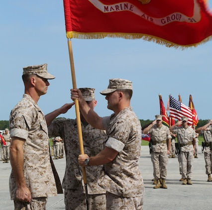 Col. William R. Lieblein passes the colors to Col. Robert D. Cooper during the change of command ceremony on the flight line aboard Marine Corps Air Station Beaufort, June 12. Lieblein thanked his family, friends and fellow Marines for their support and welcomed Cooper to his new command.