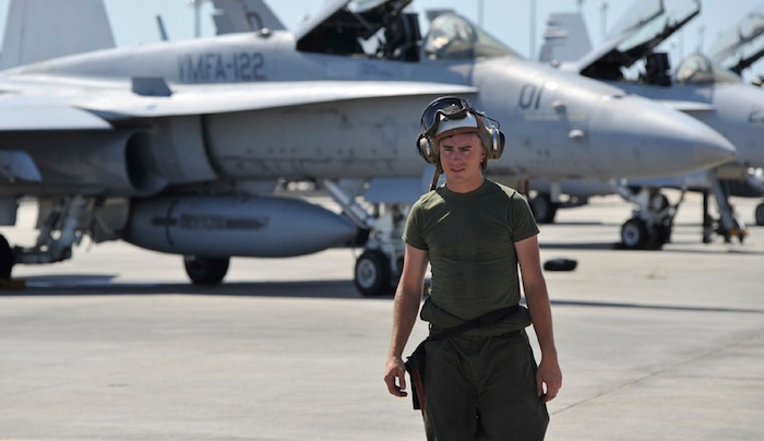 A Marine stands on the flight line before a simulated combat mission on Tyndall Air Force Base in Panama City, Fla., June 15. The training was essential for pilots and support crew to gain experience.