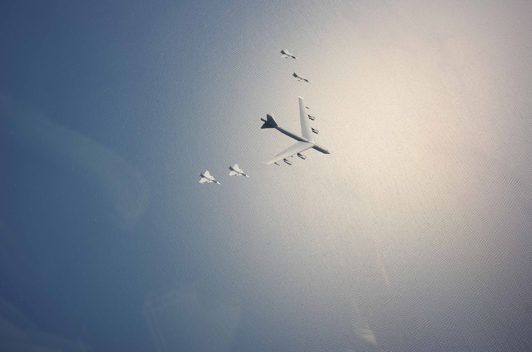 A U.S. Air Force B-52H Stratofortress leads a flight of four Swedish JAS-39 Gripens June 11, 2015, during a Baltic Operations 2015 mission over the Baltic Sea. The aircraft took part in multiple missions throughout the exercise, including Mk-62 Quickstrike mine drops and naval support functions. During this part of the exercise, the two airframes practiced aircraft intercepts and formation flights to hone skills between pilots from different countries. (Swedish Armed Forces courtesy photo)