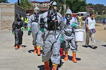 The Camp Pendleton Fire Department, the San Diego County Environmental Health Department and the U.S. Army's 9th Civil Support Team conducted a hazardous materials exercise at the Paige Fieldhouse here, June 15. The exercise was conducted in conjunction with Semper Durus, a full-scale base Force Protection exercise from June 15 – 19. Semper Durus is a regional command post exercise and is comprised of a series of field training scenarios designed to improve regional command and control, enhance interagency coordination, and improve installation capabilities to respond to, and recover from, a crisis event and validate the installation mission assurance all-hazard plan.
