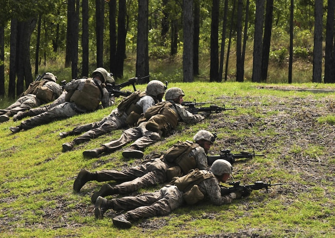 "Marines with Bravo Company, 2nd Combat Engineer Battalion, take a defensive position during a live-fire and maneuver exercise at a range aboard Camp Lejeune, N.C., June 6, 2015. The training simulated the Marine's response to encountering an enemy attack while on patrol. ""If we work together in this training we'll already know our plans, call signs and signals,"" said Sgt. Christian Sampson, a combat engineer with the company. ""We'll have a plan laid out already so when we get in a fight we'll know what to do."" (U.S. Marine Corps photo by Pfc. David N. Hersey/Released)"