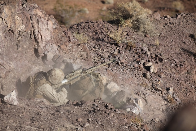 A sniper with 1st Battalion, 7th Marine Regiment, 1st Marine Division, I Marine Expeditionary Force, engages targets 880 meters away with a Barrett M82A1 Special Application Scoped Rifle during 1/7's Marine Corps Combat Readiness Evaluation aboard Marine Corps Air Ground Combat Center Twentynine Palms Calif., June 9, 2015.  Marines from 1/7 and 2nd battalion, 7th Marine Regiment are currently in preparation for deployment with the Special Purpose Marine Air Ground Task Force (SPMAGTF) scheduled to depart in support of Operation Inherent Resolve later this year.