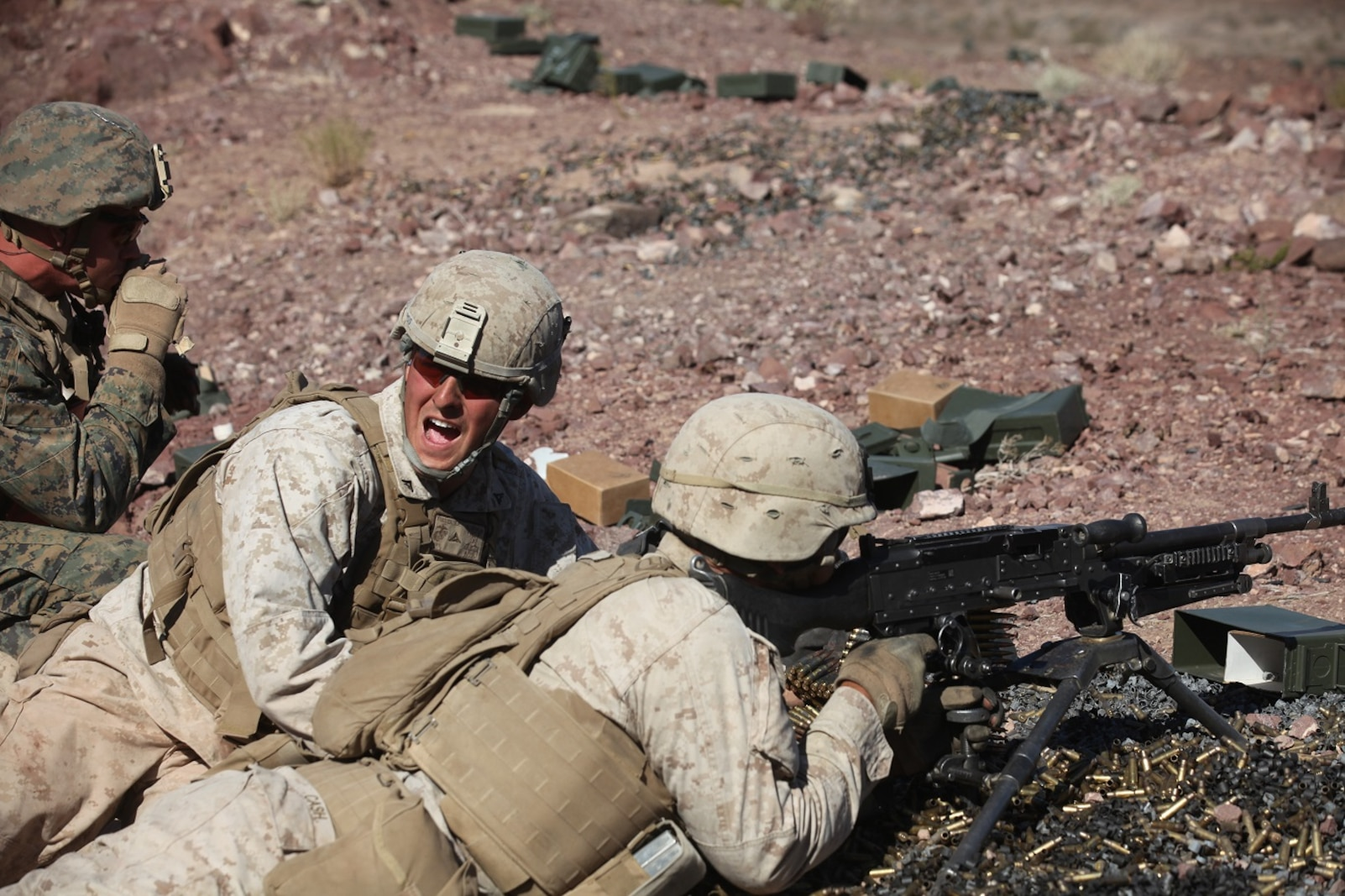 Lance Cpl. Rory Fuller, a machine gunner with 1st Battalion, 7th Marine Regiment, 1st Marine Division, I Marine Expeditionary Force, calls for his runner to bring additional ammunition during 1/7's Marine Corps Combat Readiness Evaluation aboard Marine Corps Air Ground Combat Center Twentynine Palms, Calif., June 9, 2015.  Marines from 1/7 and 2nd battalion, 7th Marine Regiment are currently in preparation for deployment with the Special Purpose Marine Air Ground Task Force (SPMAGTF) scheduled to depart in support of Operation Inherent Resolve later this year.