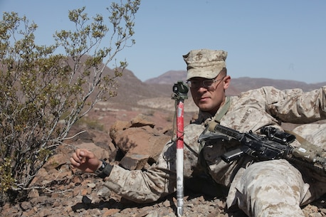 A mortarman with 1st Battalion, 7th Marine Regiment, 1st Marine Division, 1st Marine Expeditionary Force, establishes the direction of fires for his 60 millimeter mortar team during 1/7's Marine Corps Combat Readiness Evaluation aboard Marine Corps Air Ground Combat Center Twentynine Palms, Calif., June 9, 2015.  Marines from 1/7 and 2nd battalion, 7th Marine Regiment are currently in preparation for deployment with the Special Purpose Marine Air Ground Task Force (SPMAGTF) scheduled to depart in support of Operation Inherent Resolve later this year.