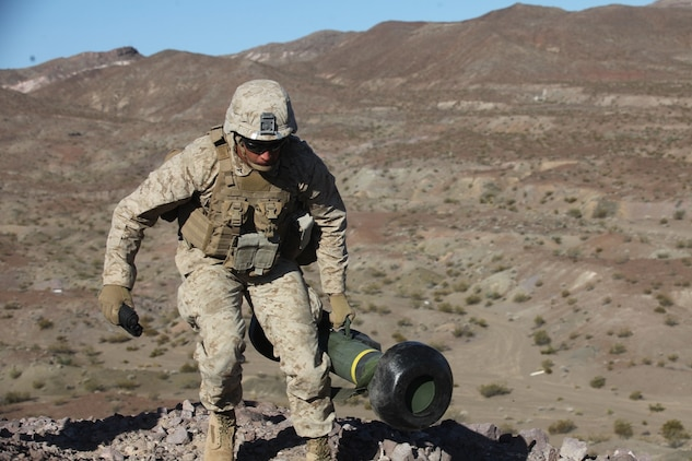 An assaultman with 1st Battalion, 7th Marine Regiment, 1st Marine Division, I Marine Expeditionary Force, moves into position to fire his FGM-148 Javelin during 1/7's Marine Corps Combat Readiness Evaluation aboard Marine Corps Air Ground Combat Center Twentynine Palms, Calif., June 9, 2015. Marines from 1/7 and 2nd battalion, 7th Marine Regiment are currently in preparation for deployment with the Special Purpose Marine Air Ground Task Force (SPMAGTF) scheduled to depart in support of Operation Inherent Resolve later this year.