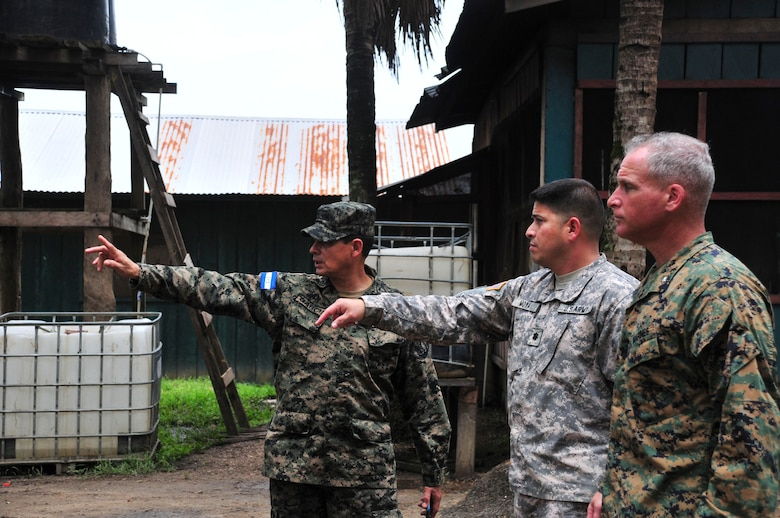 PUERTO LEMPIRA, Honduras – Honduran Army Col. Jose Garcia Maradiaga, Joint Task Force-Paz Garcia commander (left), gives U.S. Army Lt. Col. Carlos Moya, Joint Task Force-Bravo director of civil-military operations (center), and U.S. Marine Corps Lt. Col. David Hudak, Special Purpose Marine Air Ground Task Force-Southern Command commander (right), a tour of JTF-Paz Garcia June 18, 2015. The tour followed a meeting between SPMAGTF-SC, JTF-Bravo and Gracias a Dios leadership, to discuss the Marines' upcoming construction projects in the department. (U.S. Air Force Photo by Capt. Christopher Love)